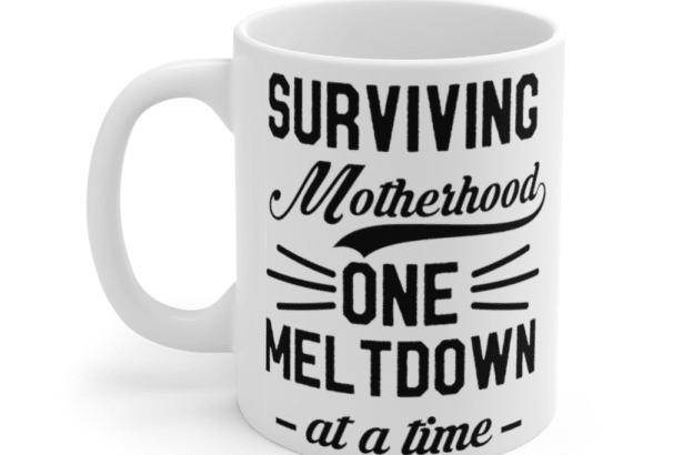 Surviving Motherhood One Meltdown At A Time – White 11oz Ceramic Coffee Mug (2)